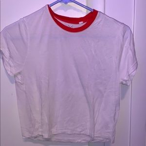 White shirt with red collar